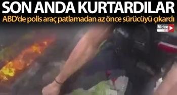ABD'de polisler, yanan aracın camını kırarak sürücüyü son anda kurtardı